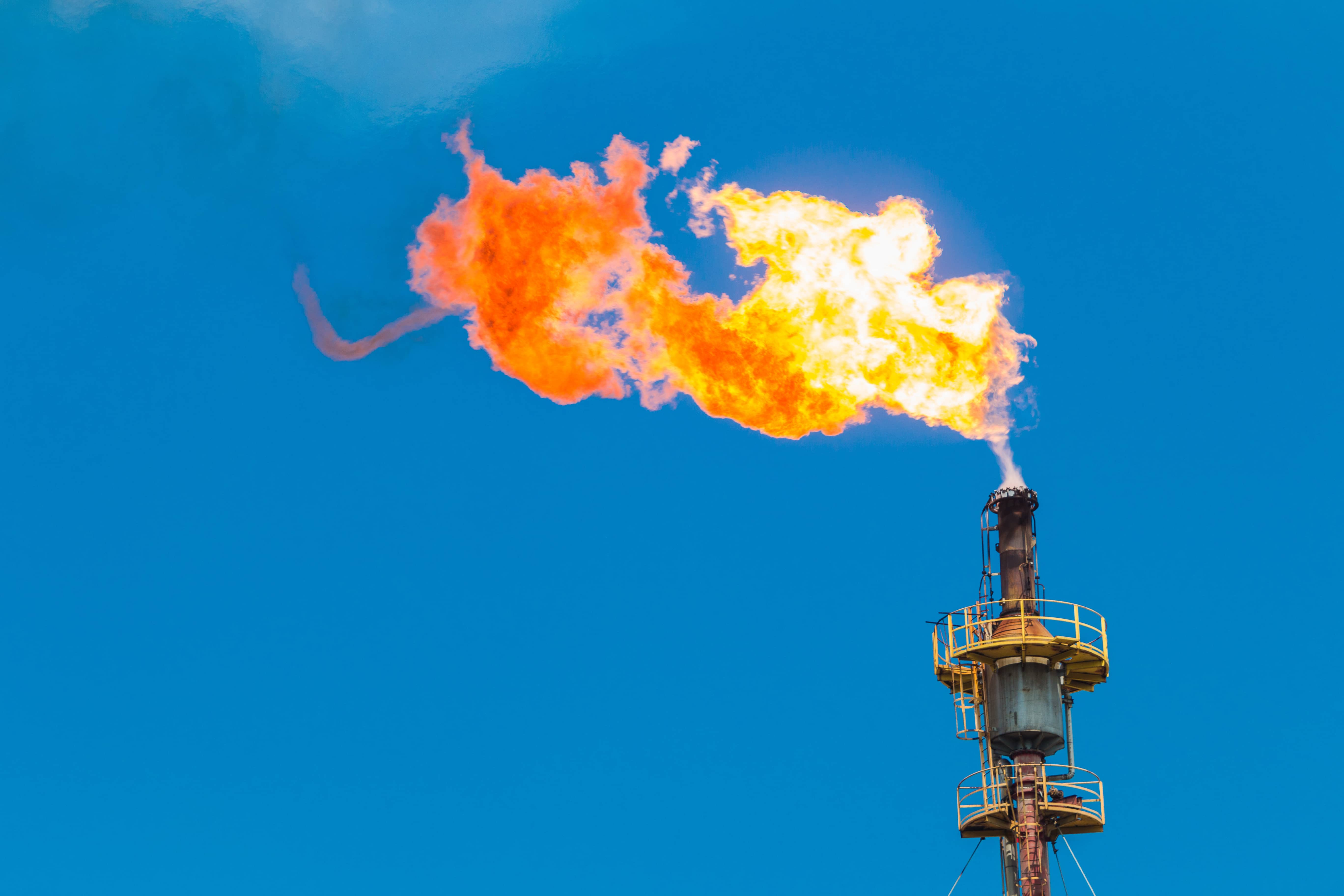 gas flare against blue sky