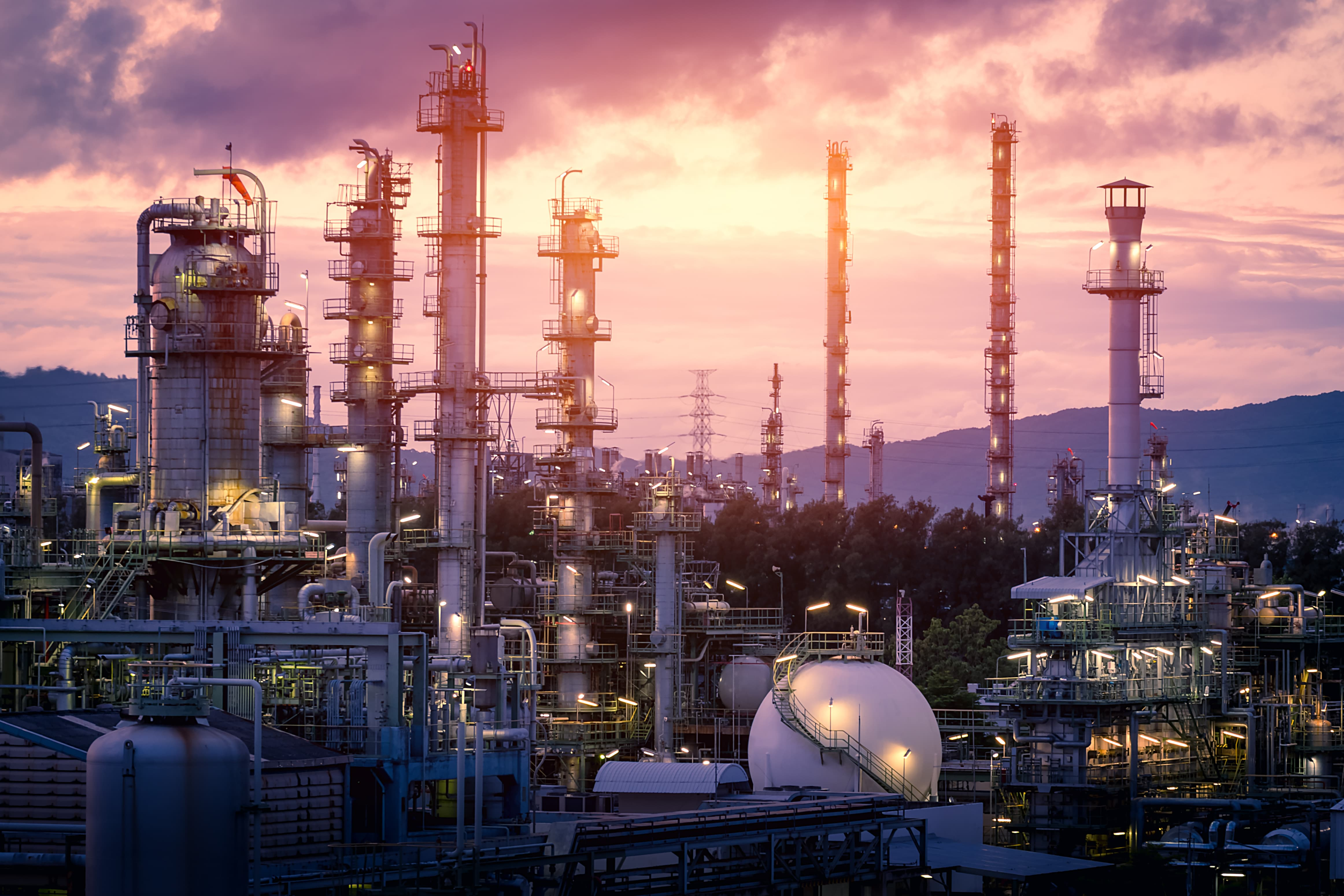 refinery in mountains at sunset