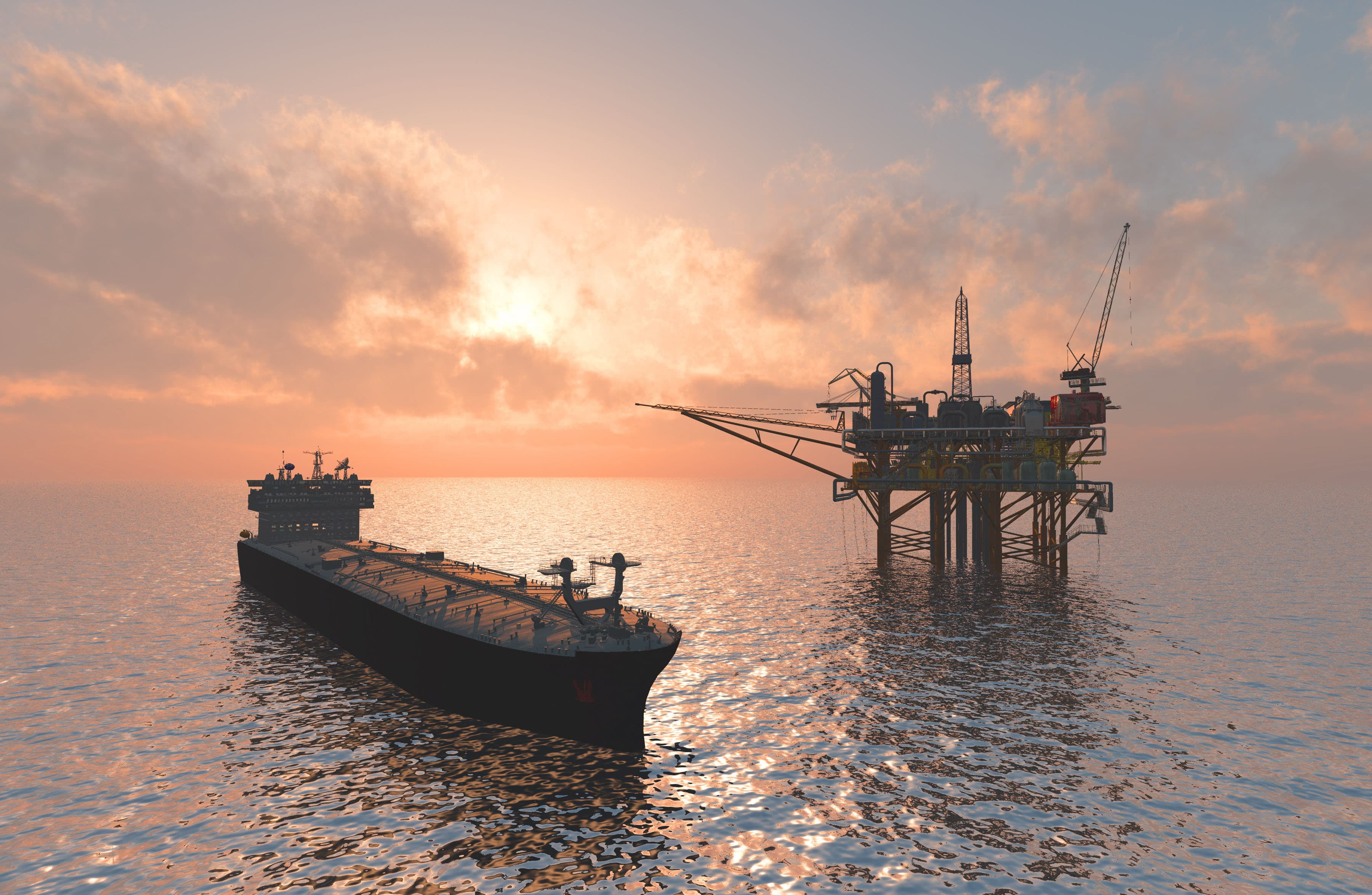 shipping tanker and oil rig at sunset